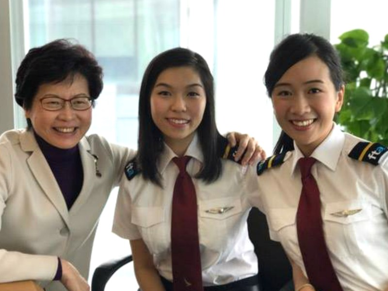 Carrie Lam (left) took a picture with two pilots on International Women's Day. Photo: Facebook /Carrie Lam