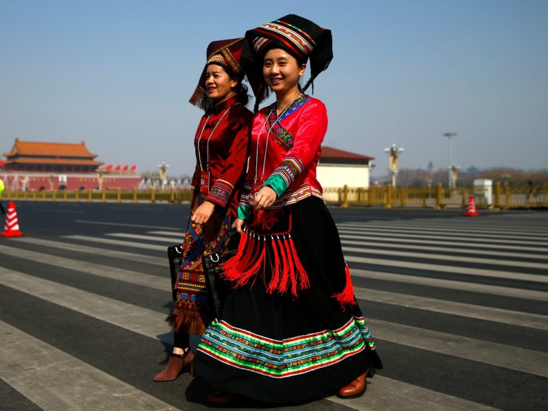 Delegates to the CPPCC in traditional costumes add a bit of color to an otherwise gray event, during which Chinese leaders are expected to focus on adding stimulus to the nation's otherwise gray economy this year. Photo: Reuters
