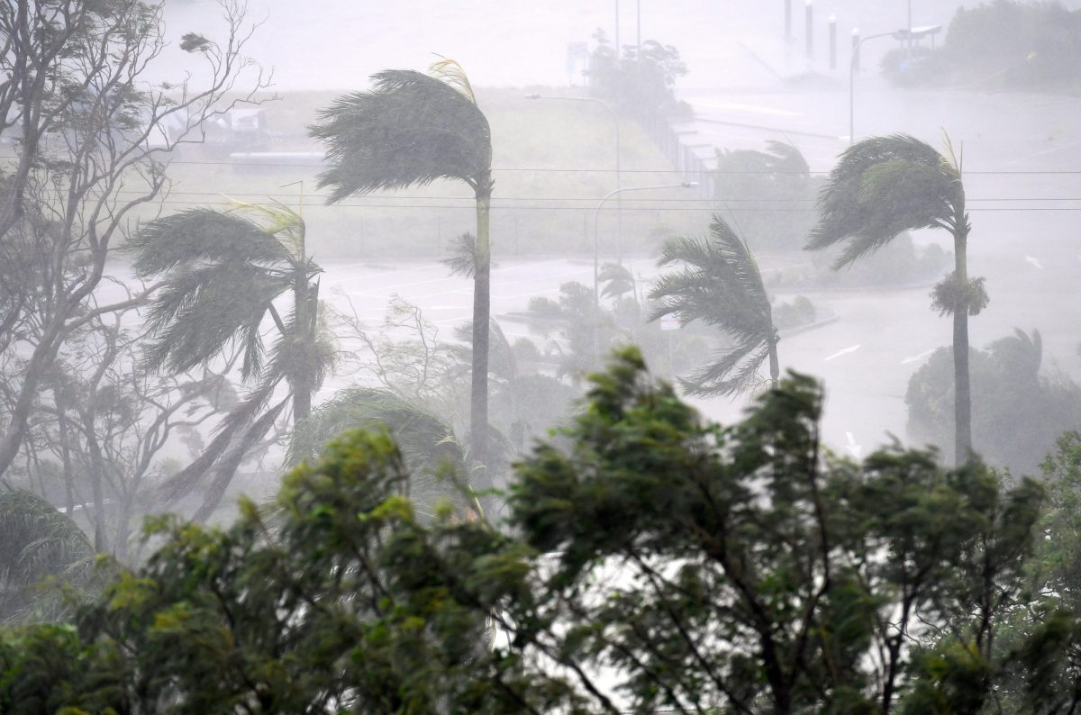 Strong wind and rain from Cyclone Debbie is seen hitting trees at Airlie Beach, located south of the northern Australian city of Townsville, March 28, 2017.  AAP/Dan Peled/via Reuters