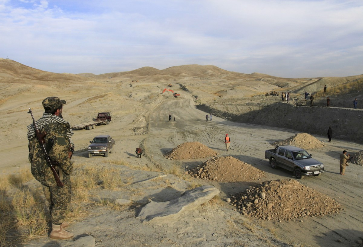 An Afghan security officer keeps watch at the site of a road being constructed by a Chinese company in Afghanistan. Photo: Reuters