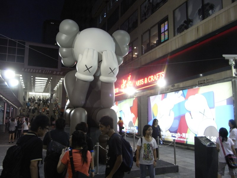 Companion, a large sculpture by  renowned artist and designer Brian Donnelly was on display at an exhibition in Hong Kong. Donnelly, known as KAWS, is collaborating with other artists and fashion designers to develop a consumer market through branding aimed at Chinese youth. Photo: Wikipedia