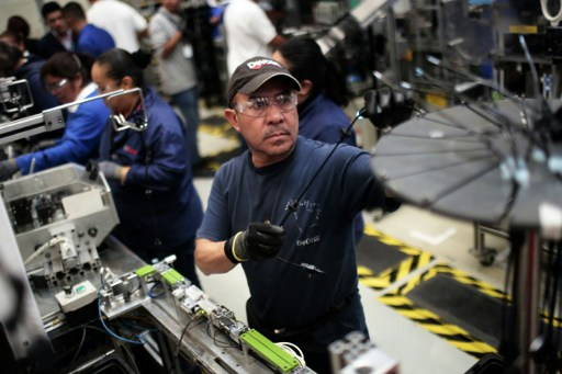 At work in the auto parts production line in the Bosch factory in San Luis Potosi, Mexico. US President Donald Trump has threatened to impose a 35 percent import tariff on companies that ship jobs to Mexico. Photo: AFP, Pedro Pardo