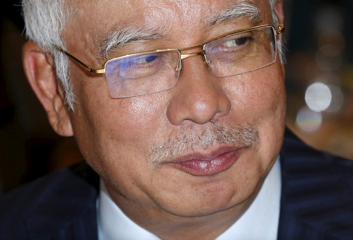 Malaysia's Prime Minister Najib Razak has survived a massive embezzlement scandal, opposition street protests and challenges from within his ruling United Malays National Organization party. Photo: Reuters / Olivia Harris