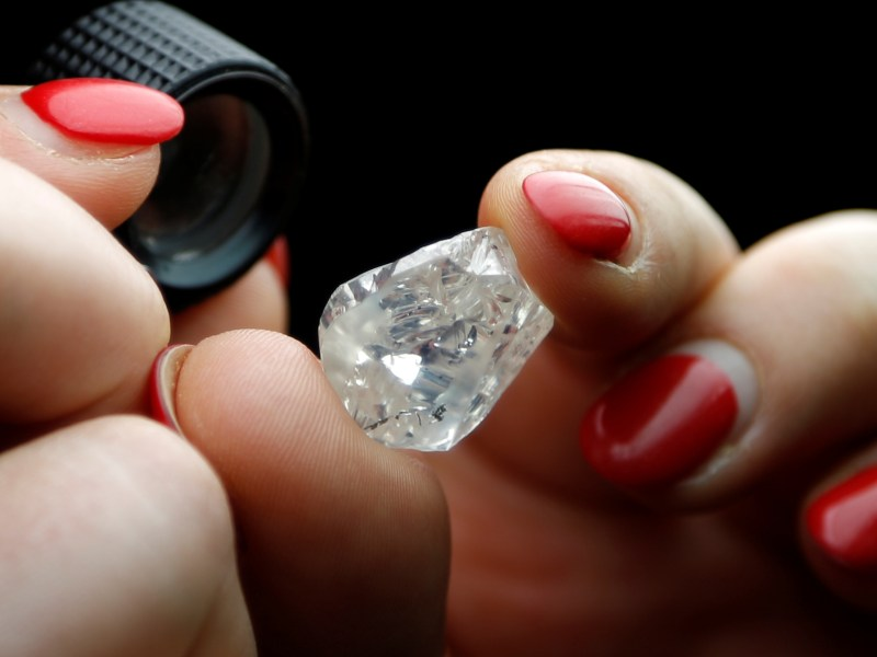 A 30-carat rough diamond is viewed at the offices of a polishing factory in Antwerp, Belgium, April 28, 2016. Reuters/Francois Lenoir