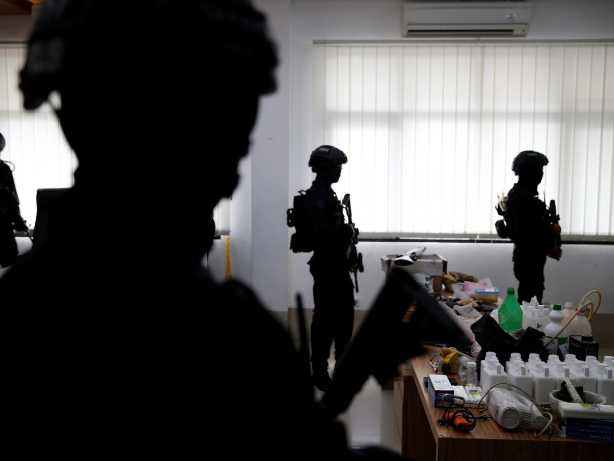 Indonesian anti-terror police stand guard near explosive materials and other evidence confiscated in raids on suspected militants during a media briefing at police headquarters in Jakarta in a file photo: Photo: Reuters/Beawiharta