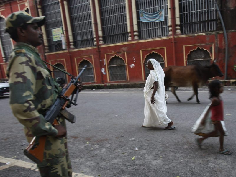A paramilitary soldier stands guard outside the High Court in the northern Indian city of Lucknow, in September, 2010. Tens of thousands of police were put on the streets as the court ruled on a centuries-old religious dispute between Hindus and Muslims. Legal rows surrounding the 16th century Babri mosque, which was attacked by Hindu activists in 1992, continue to rumble on. Photo: Reuters / Adnan Abidi
