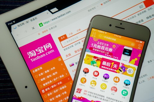 A Chinese mobile phone user browses online shopping site Taobao.com. Photo: AFP