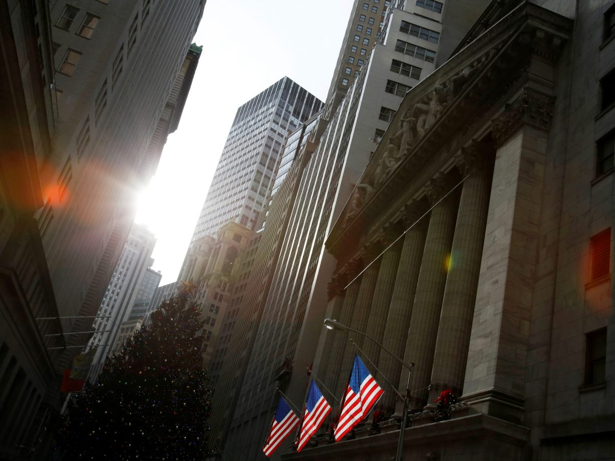 U.S. flags hang at the New York Stock Exchange in Manhattan. Photo: Reuters, Andrew Kelly