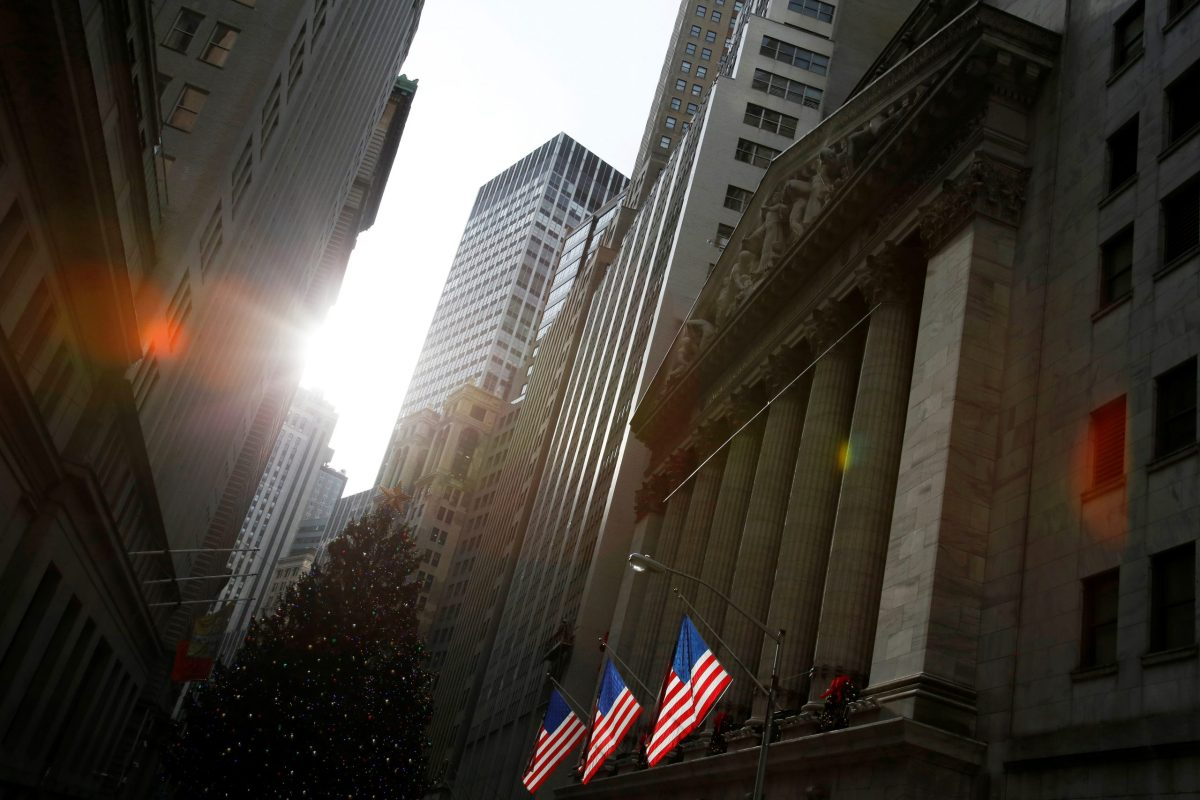U.S. flags hang at the New York Stock Exchange. Photo: Reuters, Andrew Kelly