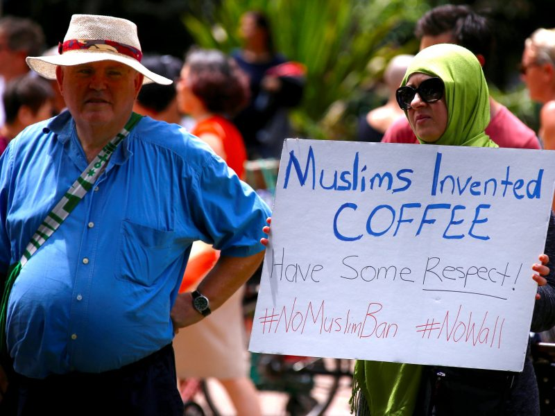 Sydney protester tells Trump to go for coffee. Photo: Reuters