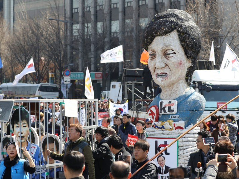 Protesters cerebrate the Constitutional Court's decision to remove South Korean president Park Guen-hye from office. The impeachment has left South Korea leaderless and its economic in a state of uncertainty. Photo: Yomiuri Shimbun