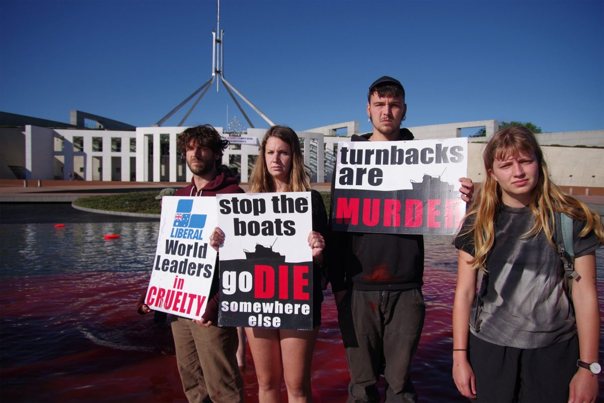 Protestors carry placards in front of the Parliament House in Canberra in December 2016 demanding the closure of offshore detention camps for refugees. Photo: AFP