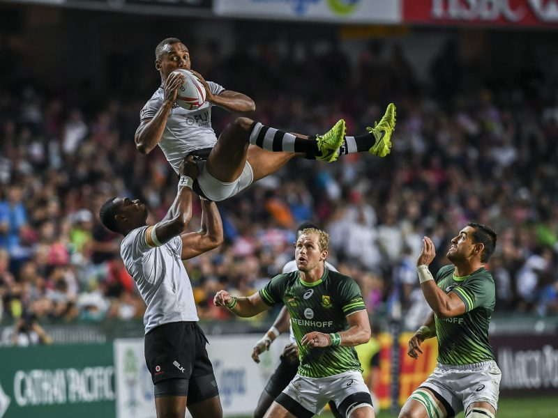 Kalione Nasoko of Fiji lifts teammate Osea Kolinisau to the ball during the Cup Final against South Africa. Photo: AFP