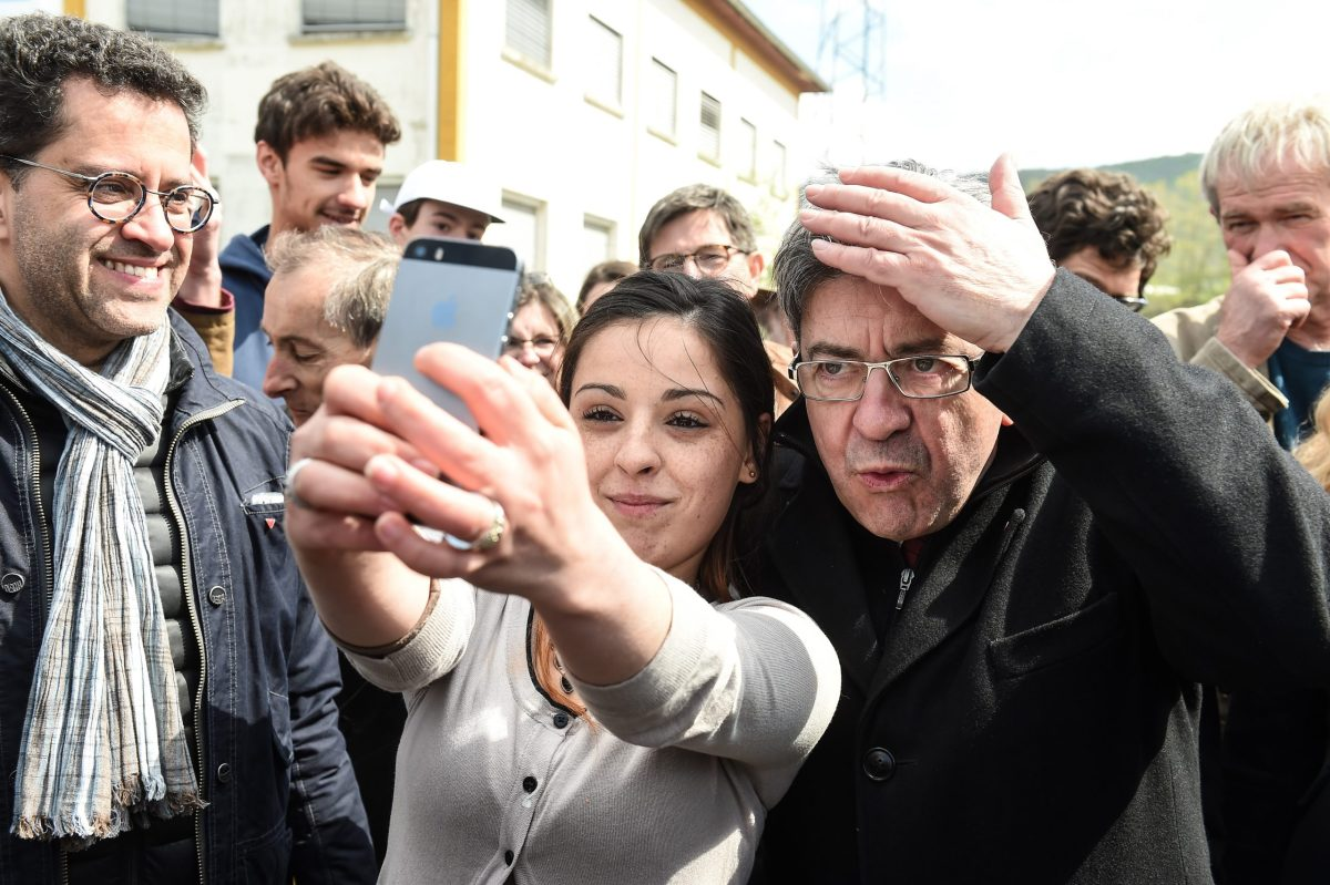 Le selfie? How gauche: Jean-Luc Melenchon poses with a fan. Photo: AFP