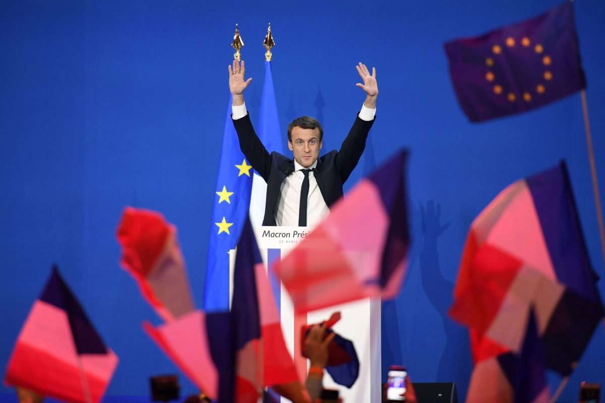 French presidential election candidate Emmanuel Macron arrives on stage to deliver a speech at the Parc des Expositions in Paris, late on Sunday. Photo: AFP
