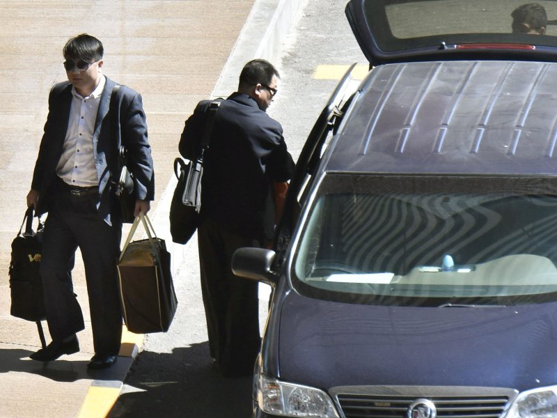North Koreans Hyon Kwang-song (right) Kim Uk-il arrive in Beijing for a flight to North Korea. Photo: Kyodo via Reuters