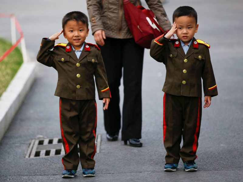 Boys in military uniforms salute for photographs at a zoo in Pyongyang, North Korea, on April 16, 2017.    Photo: Reuters / Damir Sagolj
