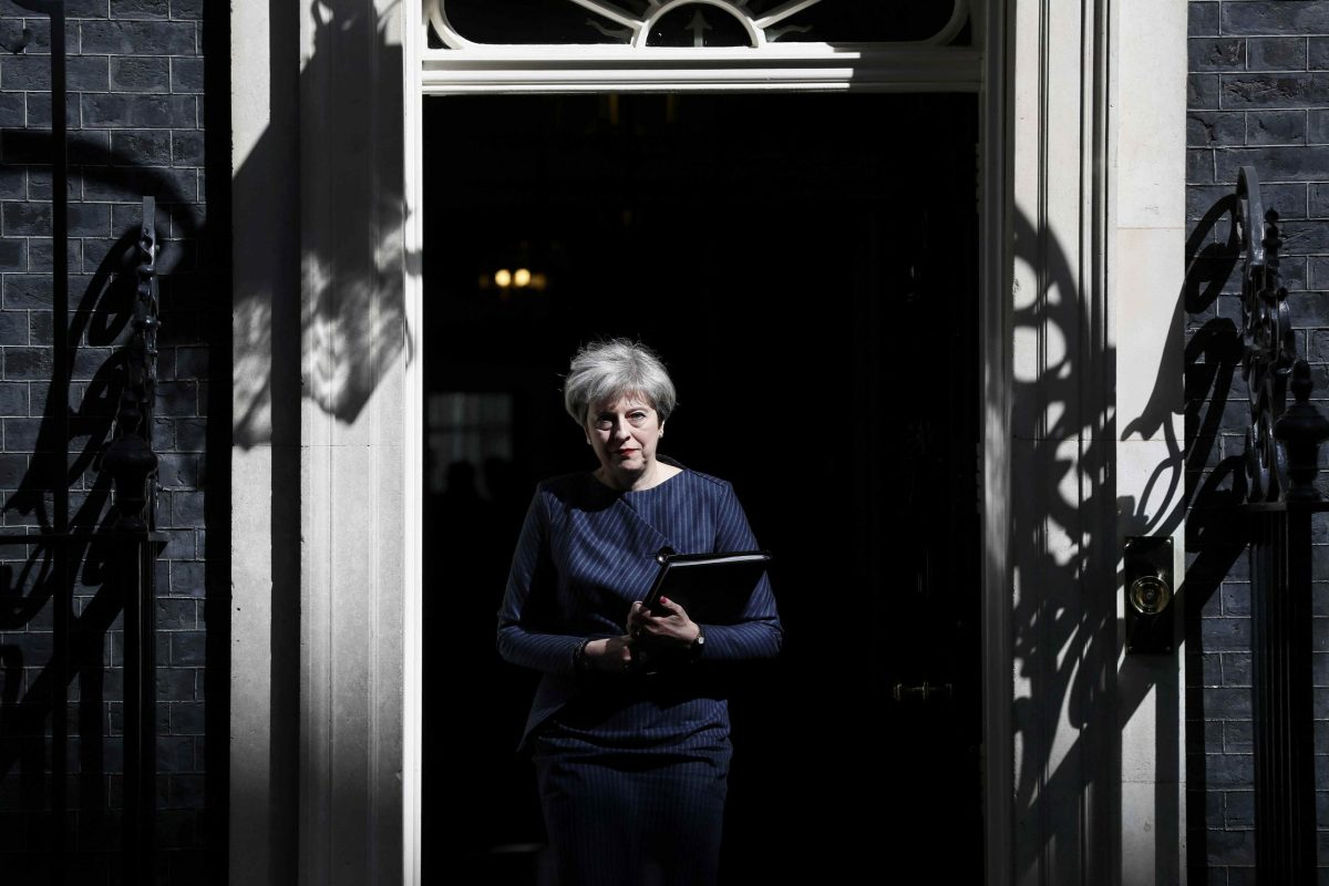 Britain's Prime Minister Theresa May prepares to speak to the media outside 10 Downing Street. Photo:       Reuters/Stefan Wermuth