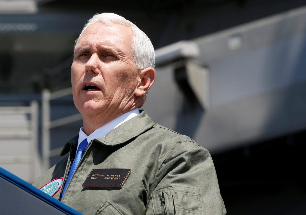 US Vice President Mike Pence delivers a speech to U.S. and Japanese service members on the flight deck of the USS Ronald Reagan, a nuclear-powered super carrier, at the U.S. naval base in Yokosuka, south of Tokyo, Japan April 19, 2017. Reuters/Kim Kyung-Hoon