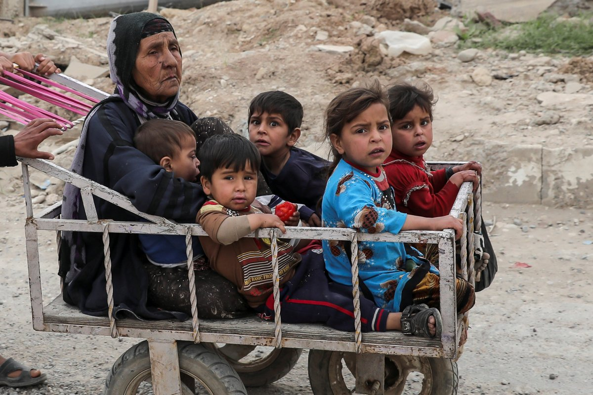 Toys are back in eastern Mosul but for others it is a different story. A displaced Iraqi woman and children are transported in a cart as the battle in western Mosul continues. Photo: Reuters/Marko Djurica