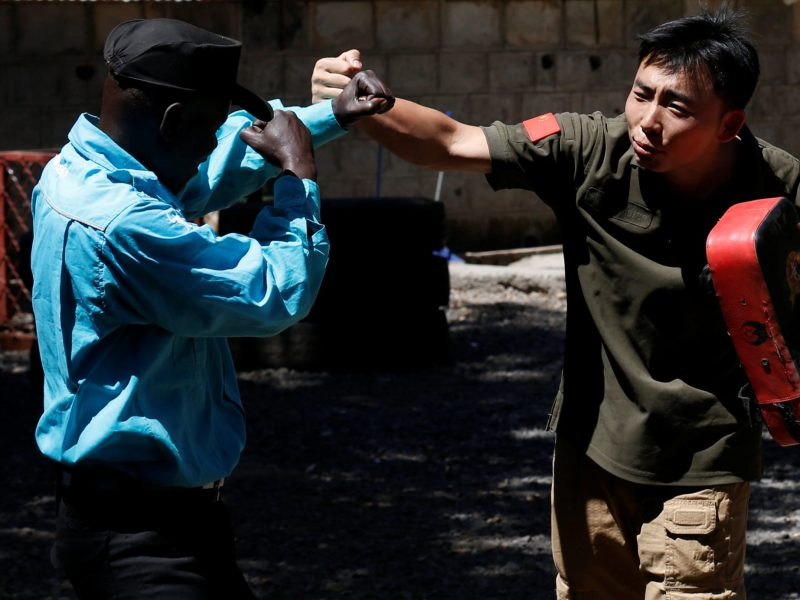 Chinese national Jack Wang, a security trainer at the Chinese-run Dewei Security Group leads Kenyan security guards in martial arts combat training at their company compound in Kenya's capital Nairobi on March 13, 2017. Photo: Reuters