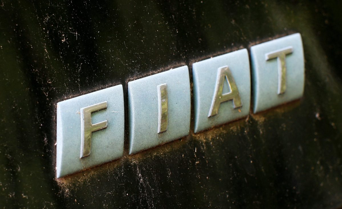 A Fiat logo is seen on a car's back at a scrapyard. Photo: Reuters/Michaela Rehle