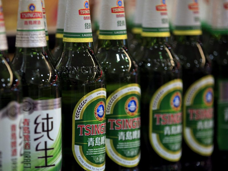 Bottles of Tsingtao beer are placed on shelves at a supermarket in Shanghai. Photo: Reuters/Aly Song