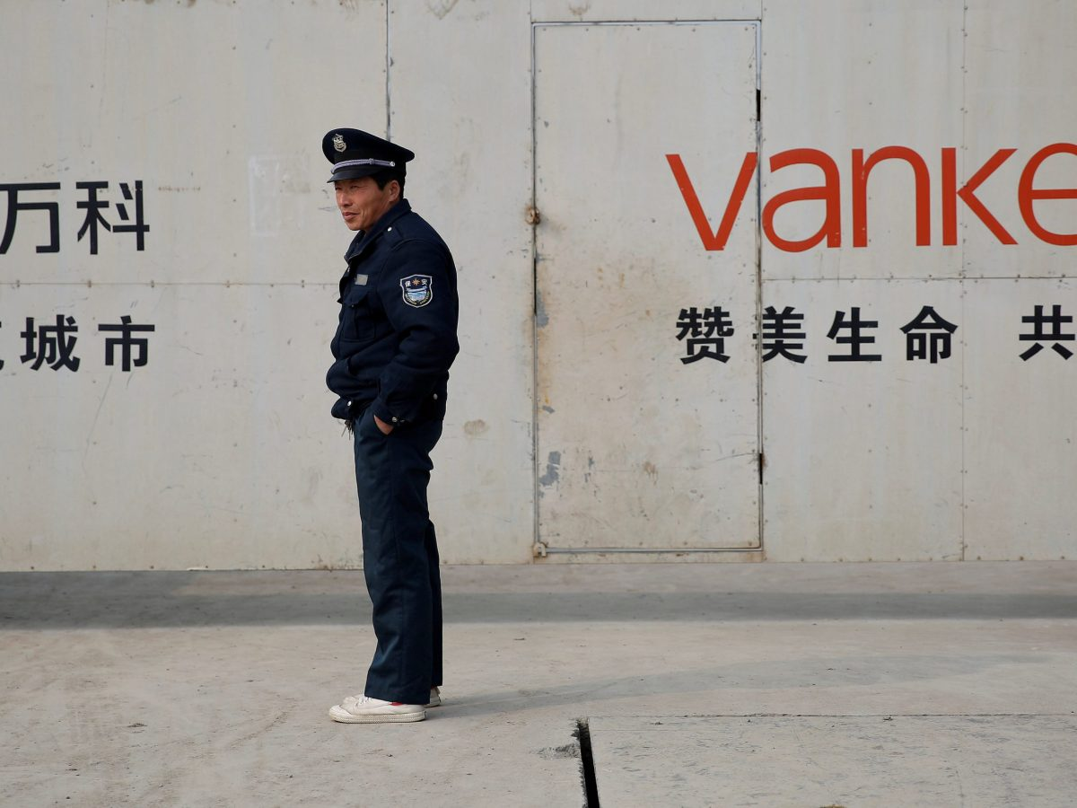 FILE PHOTO: Sign of Vanke is seen at a construction site in Shanghai. Photo: Reuters/Aly Song