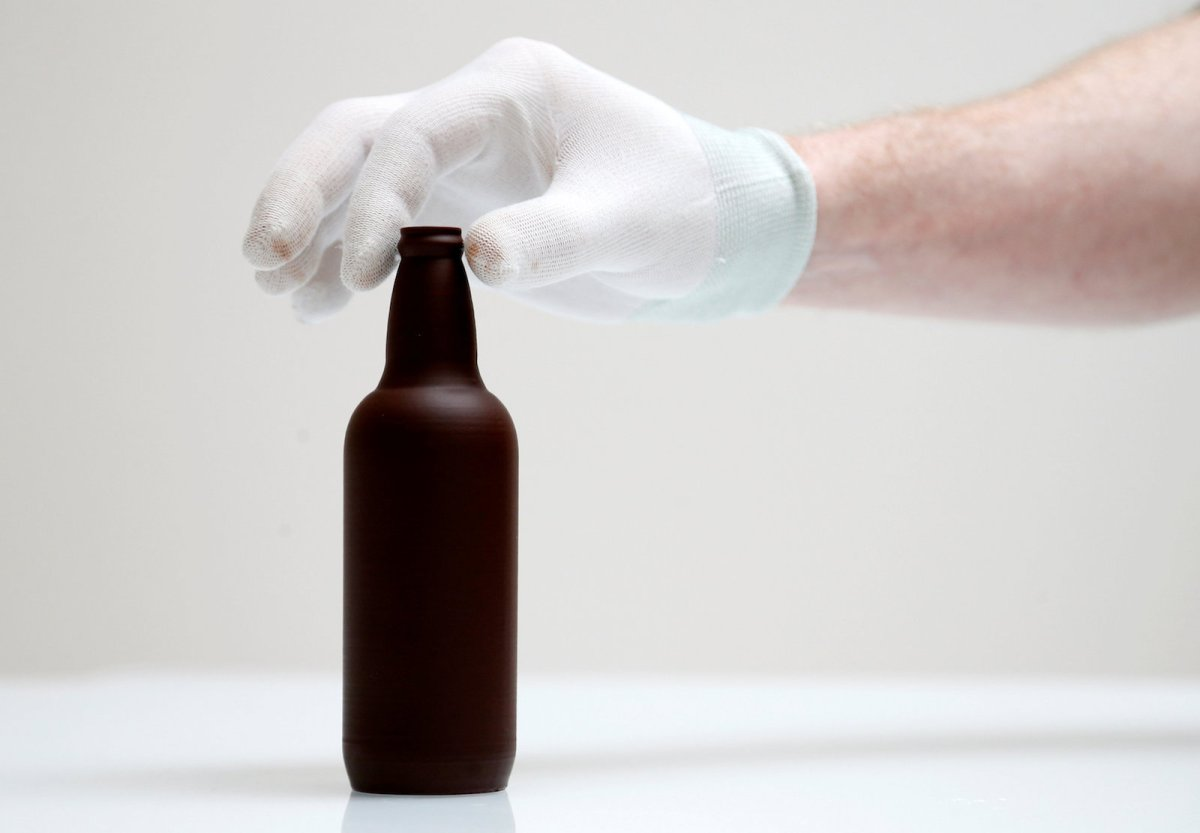 Modern technology such as 3D printing can make it easier than in the past to prototype new products. This chocolate beer bottle was printed at Miam Factory in Gembloux, Belgium, on April 10, 2017. Photo: Reuters/Francois Lenoir