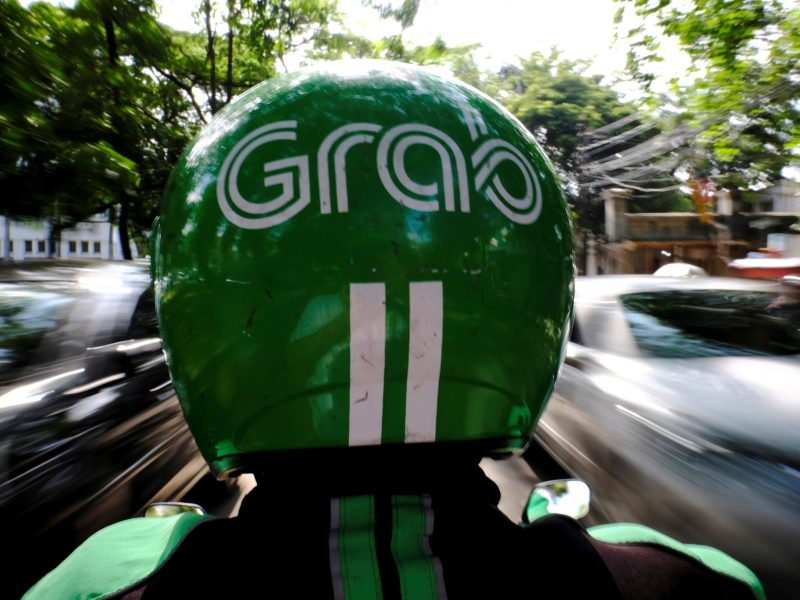 A Grab motor driver is seen in a street in Jakarta, Indonesia. Photo: Reuters / Beawiharta