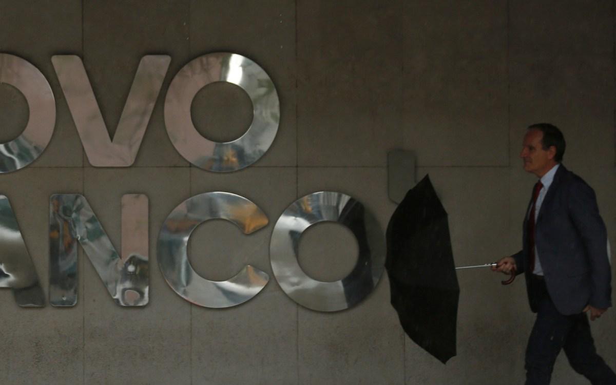 A man walks near the logo of Portuguese bank Novo Banco in downtown Lisbon. Photo: Reuters, Rafael Marchante