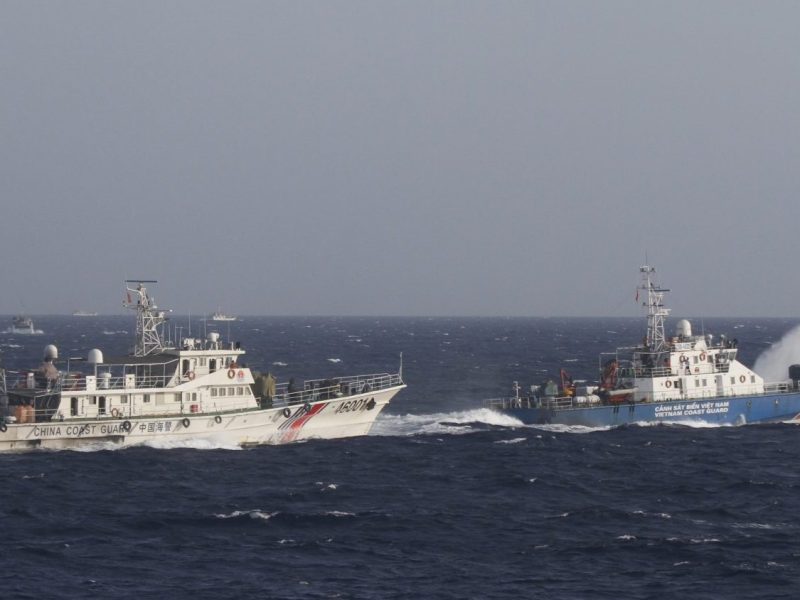 A ship (R) of Vietnam Marine Guard is seen near a ship of Chinese Coast Guard in the South China Sea, about 210 km (130 miles) off shore of Vietnam May 14, 2014. Vietnamese ships were followed by Chinese vessels as they neared China's oil rig in disputed waters in the South China Sea on Wednesday, Vietnam's Coast Guard said. Vietnam has condemned as illegal the operation of a Chinese deepwater drilling rig in what Vietnam says is its territorial water in the South China Sea and has told China's state-run oil company to remove it. China has said the rig was operating completely within its waters. REUTERS/Nguyen Minh (POLITICS MARITIME ENERGY) - RTR3P56I