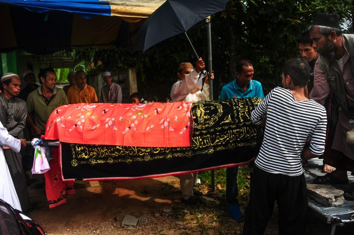 This photo taken on February 1, 2017 shows villagers carrying the coffin of a deceased couple to the graveyard of a mosque after they were shot dead in their home the night before by suspected separatist militants, in the Rangae district of Thailand's southern province of Narathiwat. Photo: AFP/Madree Tohlala