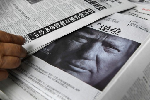 Newspaper featuring a photo of US President-elect Donald Trump at a news stand in Beijing. Photo: AFP/Greg Baker