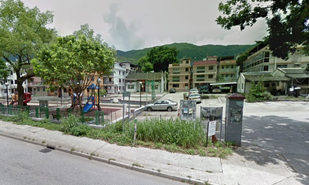 A man was seen taking sleeping garments from outside a village house in Tuen Mun. Photo: Google Map