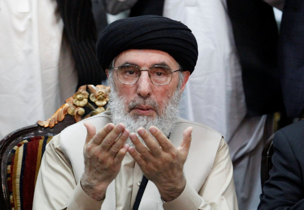 Afghan warlord Gulbuddin Hekmatyar prays before giving a speech to supporters in Jalalabad, Afghanistan, on April 30. Photo: Reuters