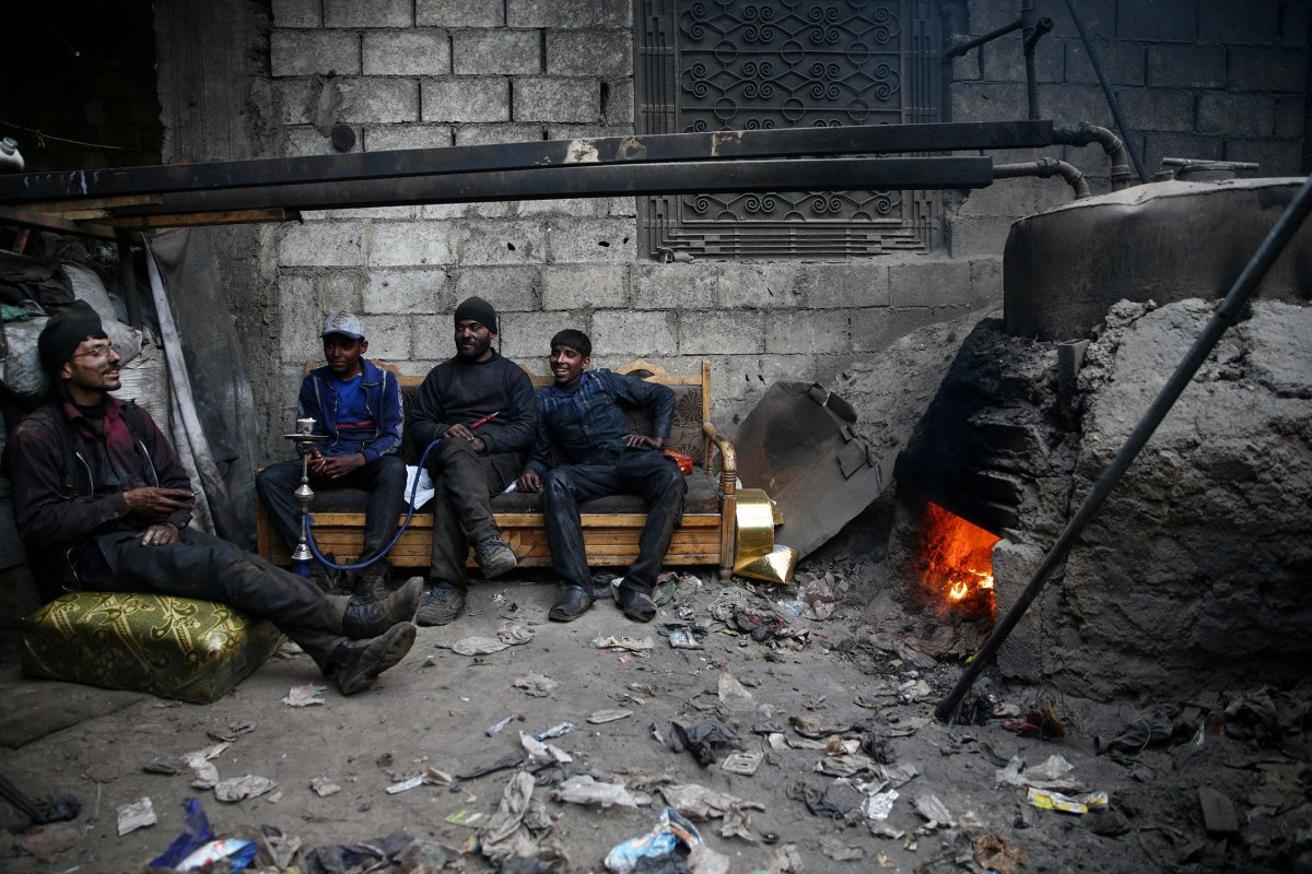 Men rest at workshop in the rebel-held Douma neighbourhood of Damascus, Syria, on April 1, 2017. Photo: Reuters