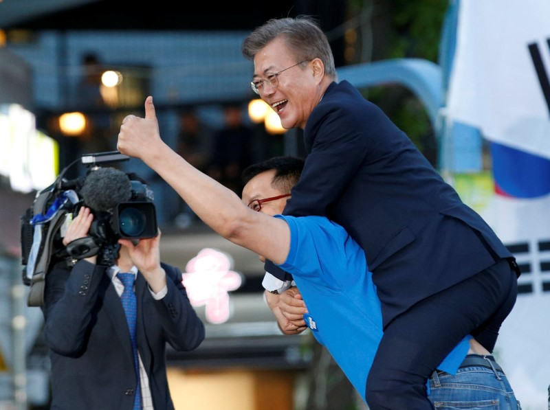 A supporter carries presidential candidate Moon Jae-in at rally ahead of Tuesday's vote. Photo: Reuters, Kim Kyung-Hoon