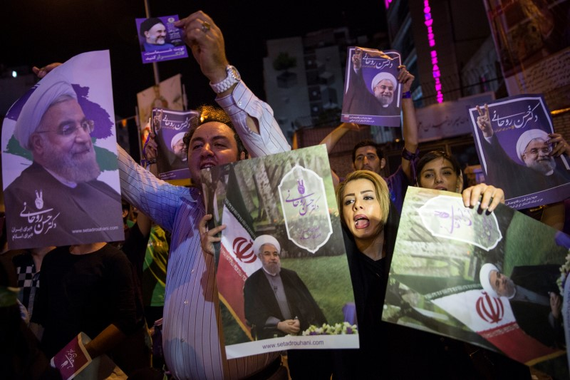 Supporters of Iran's President Hassan Rouhani hold his posters during a campaign rally in Tehran, Iran, May 17, 2017.  Photo: TIMA via Reuters