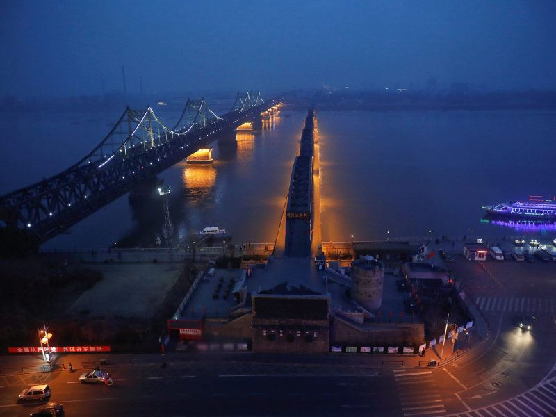 Lights are switched on along the Friendship and Broken bridges that link the North Korean town of Sinuiju and Dandong in China's Liaoning province. Photo: Reuters/Damir Sagolj