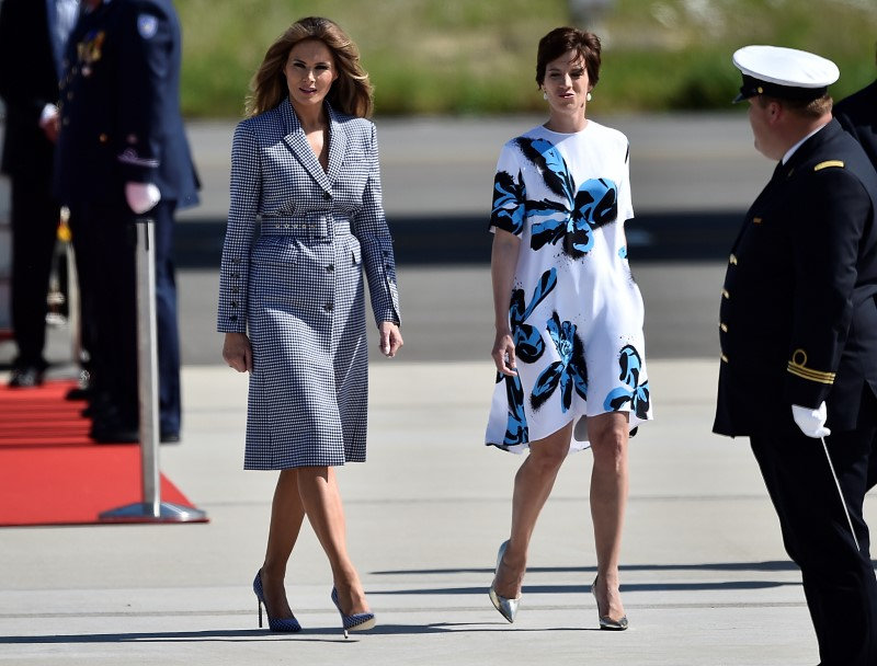 US First lady Melania Trump walks with Amelie Derbaudrenghien, partner of Belgian's Prime Minister Charles Michel, at the Brussels Airport. Photo: Reuters/Hannah McKay