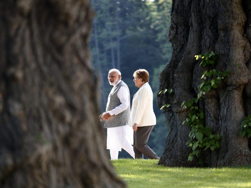 German Chancellor Angela Merkel listens to India's Prime Minister Narendra Modi in Meseberg, Germany. Photo: Reuters/Fabrizio Bensch