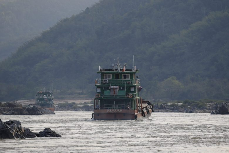 Chinese cargo ships sail on the Mekong near the Golden Triangle at the border between  Myanmar, Laos and Thailand in March 2016. Patrols on the river by the Laotian army and Myanmar police have subdued pirates but drug production and trafficking in the region is booming - despite the presence of Chinese gunboats. Photo: Reuters