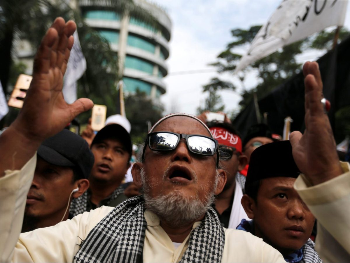 """Hardline Muslims react to the verdict in Basuki """"Ahok"""" Purnama's blasphemy trial outside the court in Jakarta on May 9, 2017. Photo: Reuters"""
