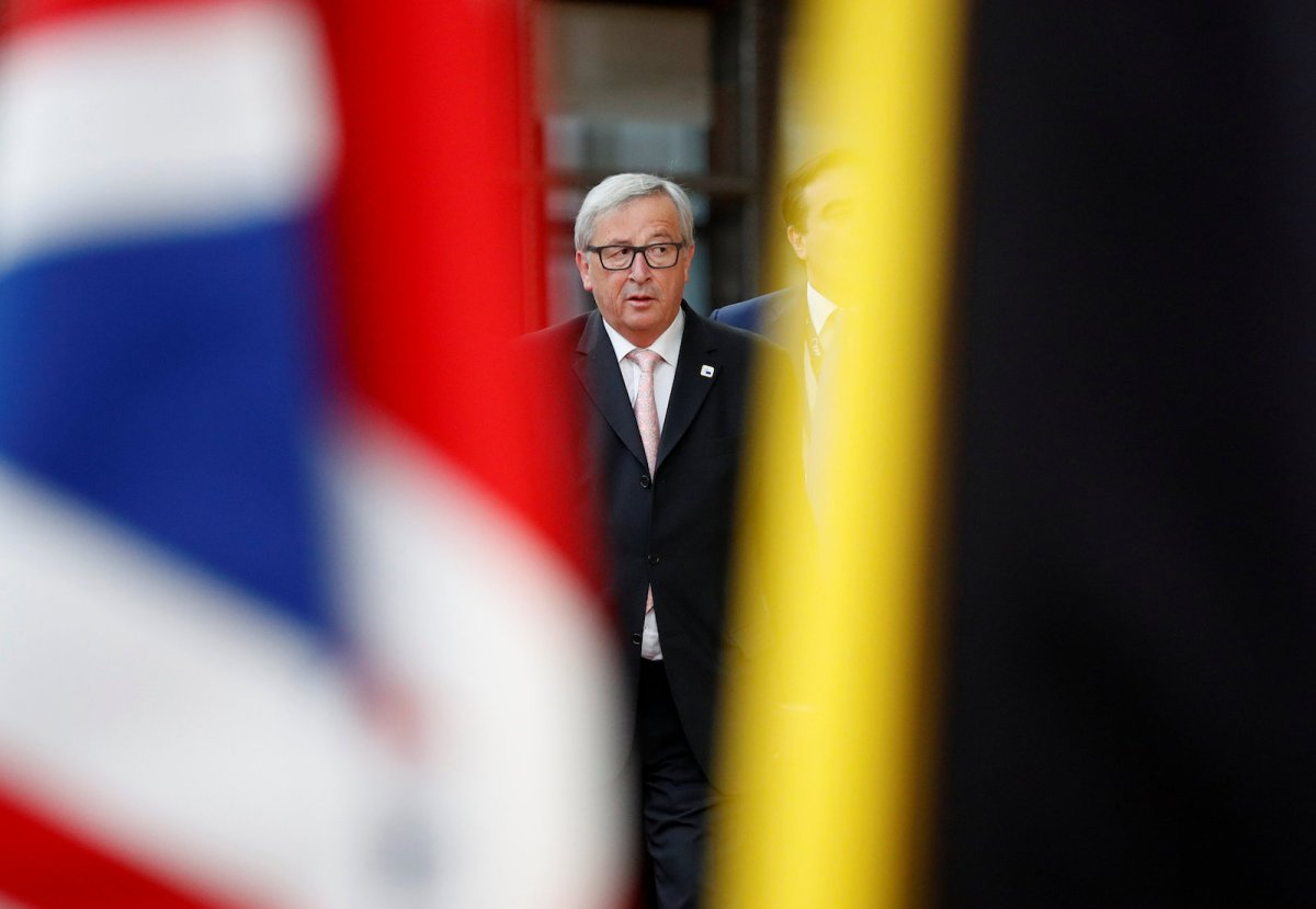European Commission President Jean-Claude Juncker walks past the Union Jack as he arrives at an EU summit in Brussels. Photo: Reuters/Christian Hartmann