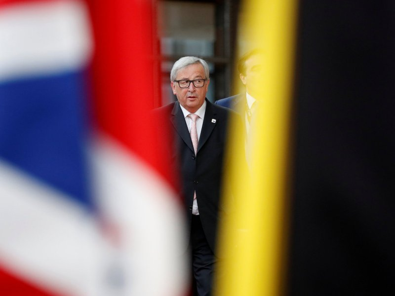 European Commission President Jean-Claude Juncker walks past the Union Jack as he arrives at an EU summit in Brussels. Photo: Reuters/Christian Hartmann