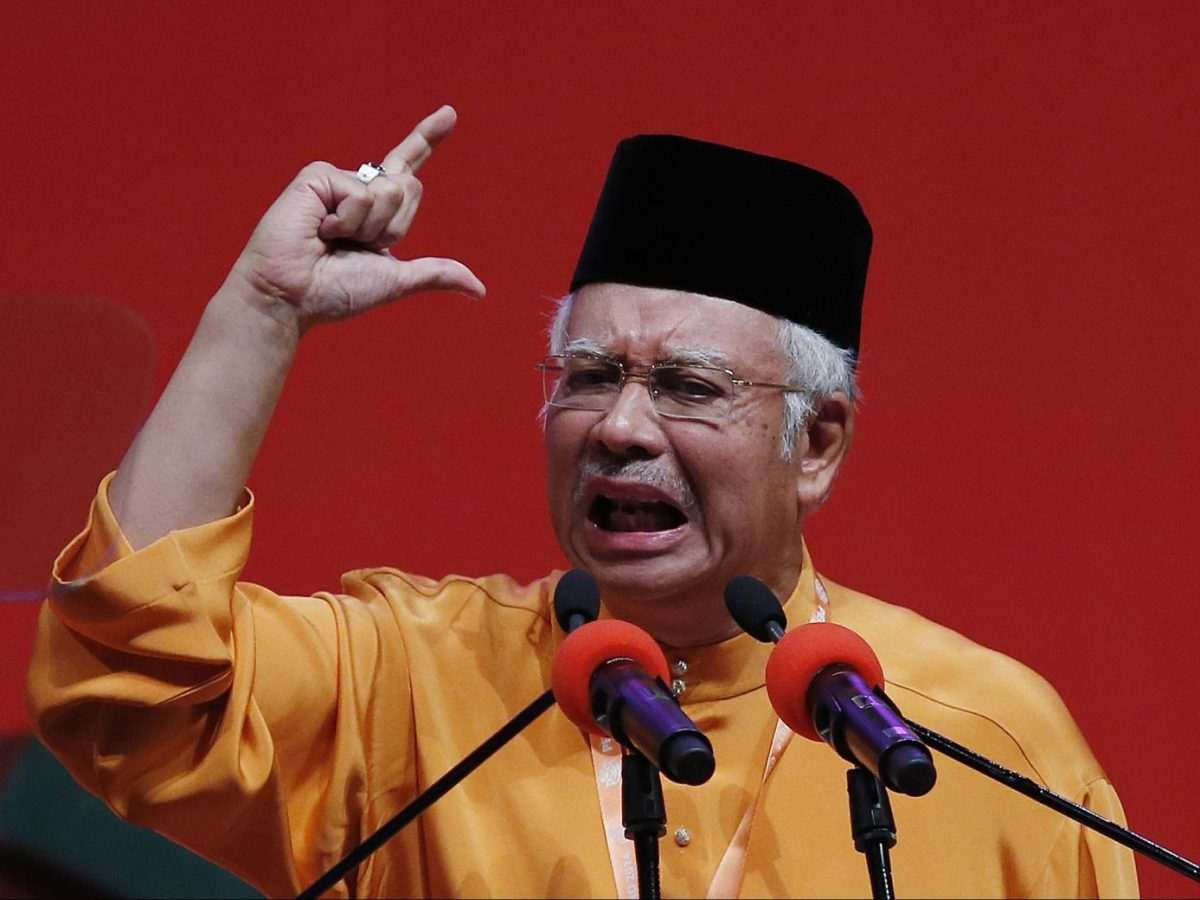 Malaysia's Prime Minister Najib Razak gives the keynote address during the his ruling United Malays National Organization (UMNO) annual assembly in a file photo. Reuters/Olivia Harris