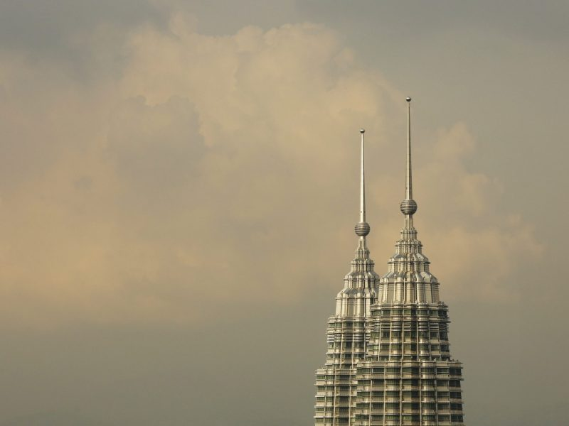 The peaks of the Petronas Twin Towers seen in central Kuala Lumpur, August 16, 2014. Photo: Reuters/Olivia Harris