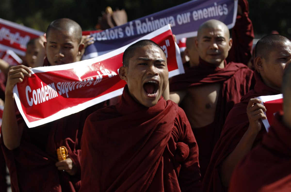 Buddhist monks protest alongside activists (not pictured) against United Nations Secretary-General Ban Ki-Moon for using the term Rohingya during the Asean summit in Yangon November 29, 2014. REUTERS/Soe Zeya Tun