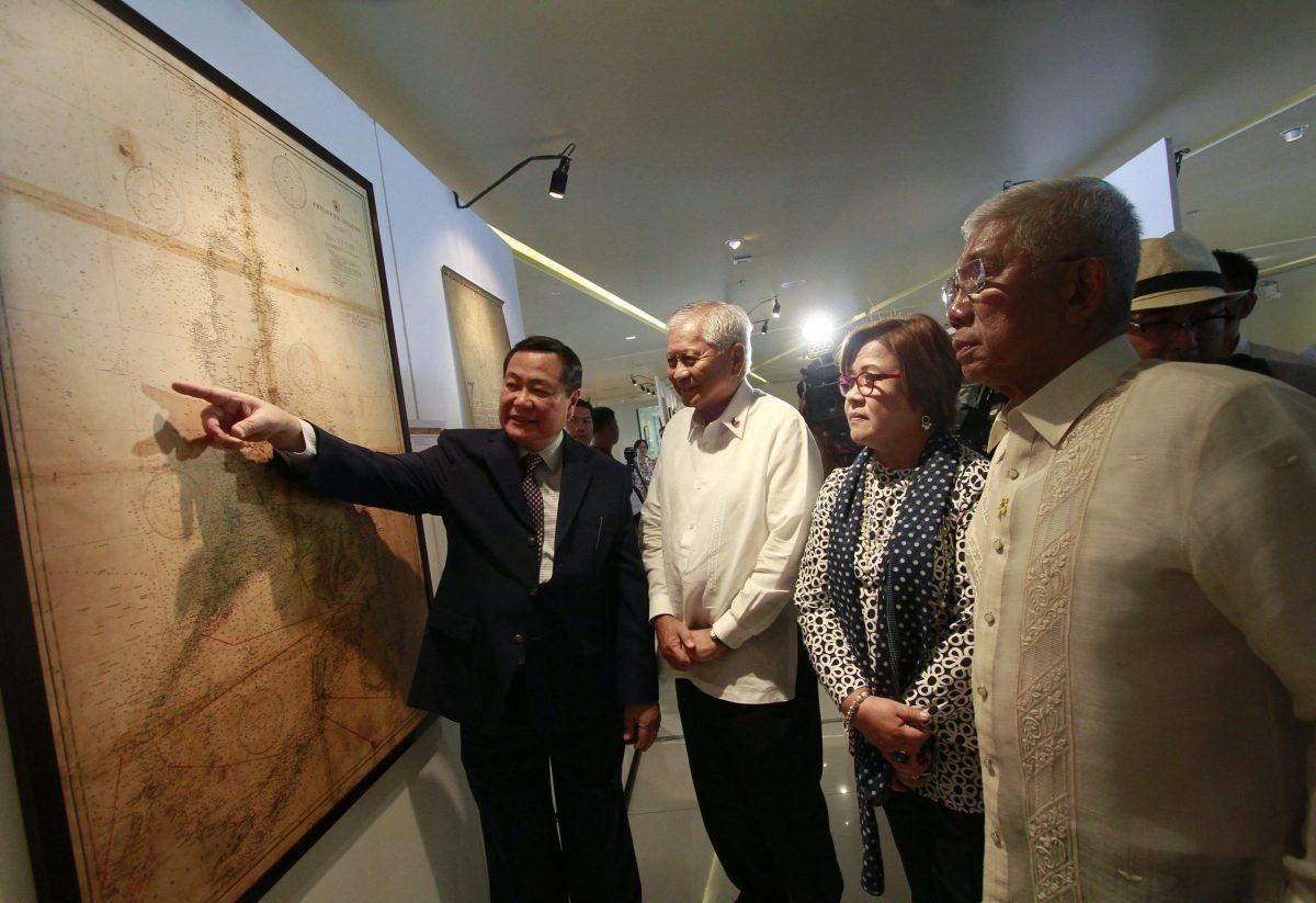 Antonio Carpio (left) points to an ancient map. Photo: Reuters